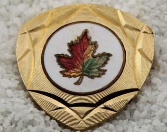 Vintage Maple Leaf Goldtone Brooch White ceramic center