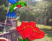 Humming Bird Suncatcher with Bright Red Flower