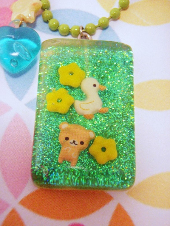 CLEARANCE SALE Duckie and Bear Frolicking in a Field of Flowers Under Resin Pendant Necklace Green Yellow Blue