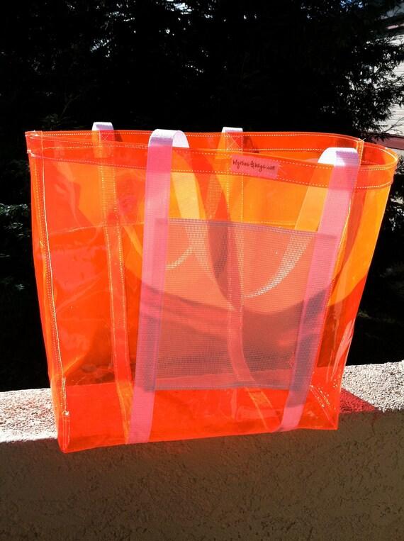 Large OrangeNeon plastic with bright white straps tote bag.