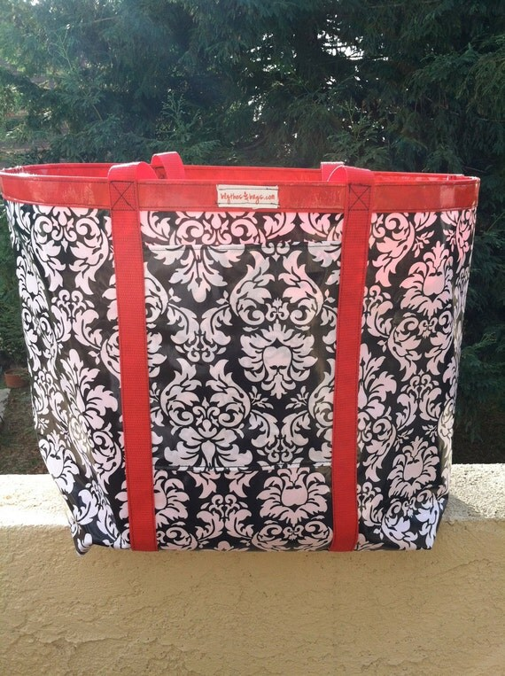 Large black, white and red oil cloth and laminated tote.