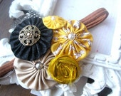 bumble bee rosette headband in black white and mustard