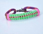 Purple and neon green bracelet with rhinestones