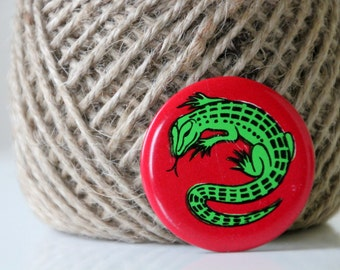 Vintage USSR badge with a green lizard