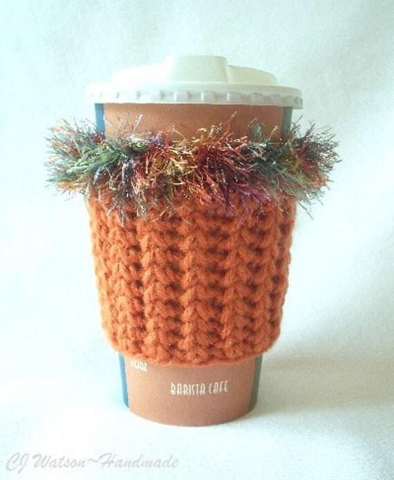 Crochet Coffee Cup Cozy Sleeve Burnt Orange and a Variegated Orange Purple and Green Eyelash yarn Trim
