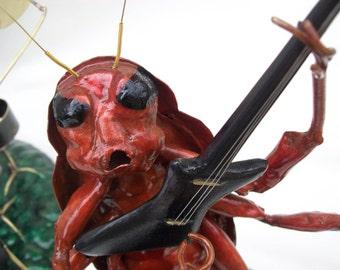 Arlof, Bass and Lead Guitarist  of  Roach  D.O.A.