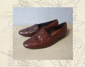 Brown leather woven flats