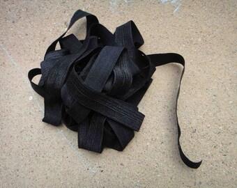 Black fold over elastic 5 yds.