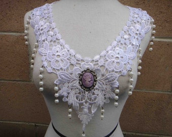 Beautiful white applique with beats hanging and a cameo buckle on the middle 1 piece listing