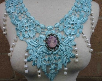 Beautiful venice turquoise applique with beats hanging and a cameo buckle on the middle 1 piece listing