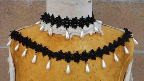 Very nice embroidered black trim  with  hanging beats 1 yard listing 1 inch wide lace 1 1/2 inch wide beads