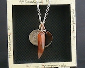 man necklace with multiple storytelling charms