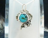 handcrafted pendant with bezel set turquiose in sterling silver