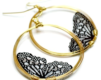 Two tone butterfly wings earrings was 28 dollars