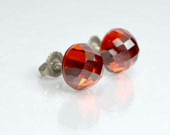 Faceted round red CZ sterling silver stud earrings