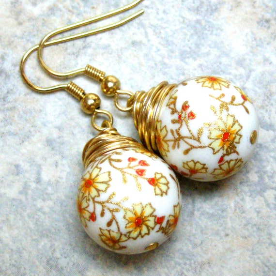 Orange flower on white background Tensha beads gold tone earrings