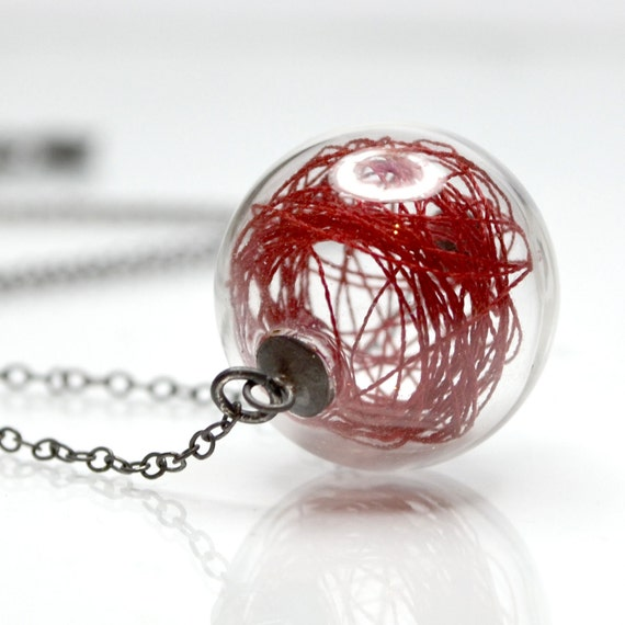 Red thread in hand blown glass antiqued sterling silver necklace