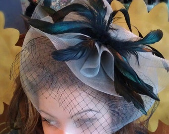 Glamour Fascinator grey with black feathers and black veil.