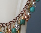 Turquoise, Sterling, Brass, and Copper Dangle Bracelet   45-101