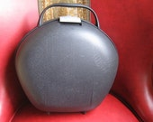 RESERVED for dbaldana Super Sale 1980s Fabulous round Black carry on hard plastic luggage