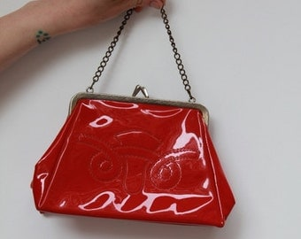 Rare Rare Rare 1950s red shiny clutch with embossed detailing in front burlesque rockabilly