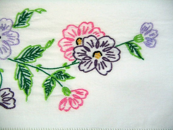 Two colorful hand embroidered queen size pillowcases in  flower motif.