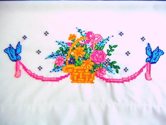 2 Q. pillowcases  with a basket of flowers and blue birds