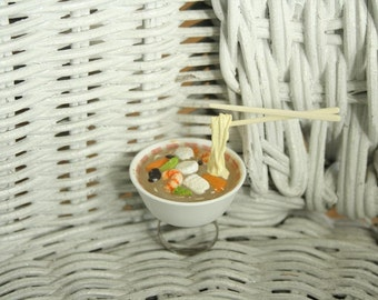 Japanese seafood floating ramen noodle bowl ring.