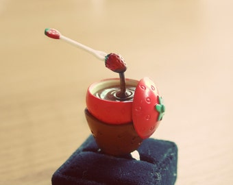 Floating Chocolate Fondue with strawberry fruit ring