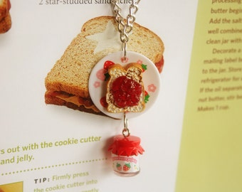 Strawberry jam jar and strawberry jam on a bread necklace