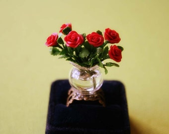 Red roses in a vase ring