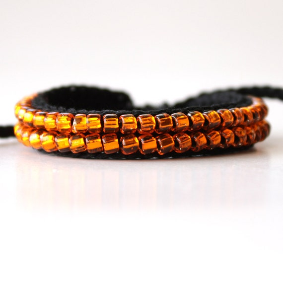 Black and Transparent Orange Beaded Bracelet