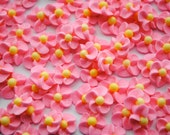 50 Handmade Pink Sparkling Royal Icing Flowers with Yellow Matte Sugar Pearl Center