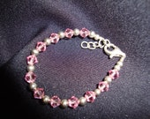 Baby bracelet with lt. rose swarovski crystals and sterling silver