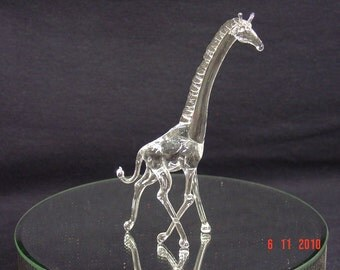 small glass giraffe