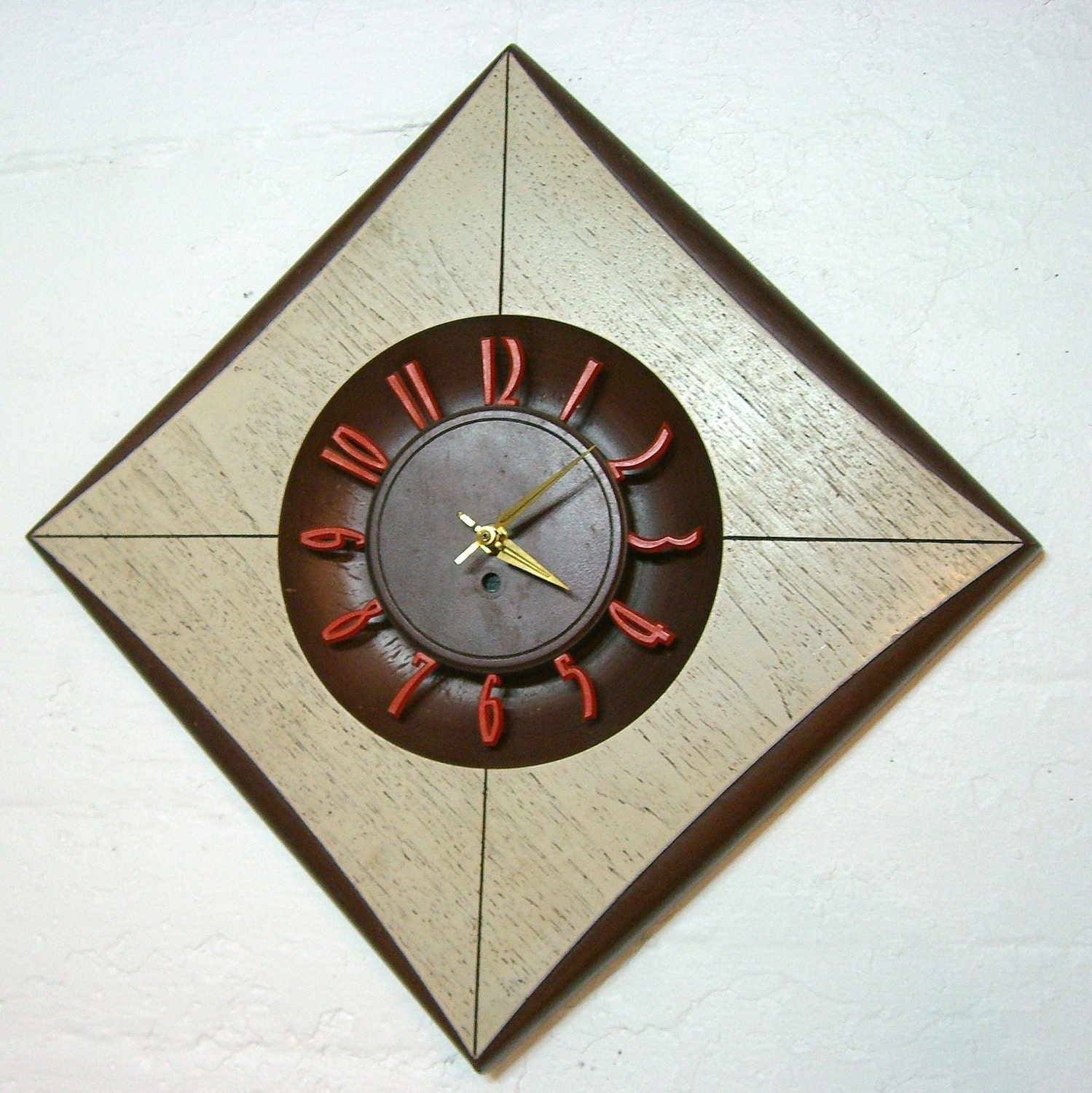 swanky mid century modern wall clock diamond shaped