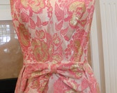 """Marilyn Monroe styled """"Mardi Gras"""" label pink and gold vegas show girl style dress with a fin-tail front."""