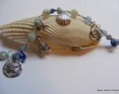 Aquamarine Nautical Bracelet. Sealife. Lobster. Sterling Silver. Neptune. Starfish. Blue Topaz.