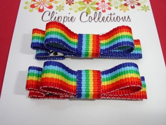 Pair of boutique mini hair bow clippies - Rainbow stripes - no slip grip