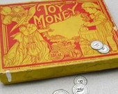 Vintage Toy Money Educational box with fabulous lithograph of children playing dress up - great red or yellow retro kitchen display