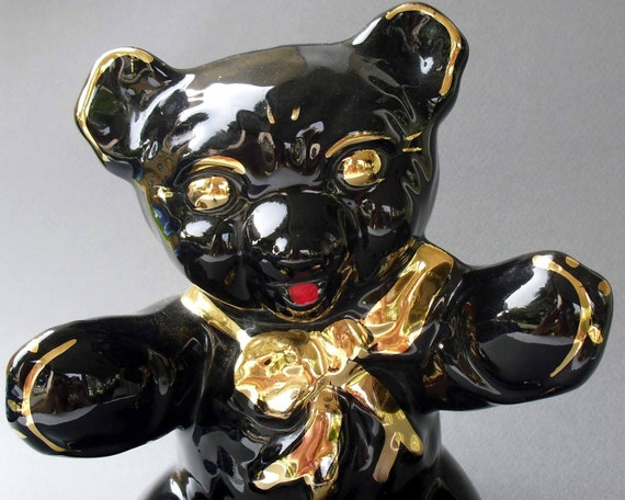 Vintage teddy bear bank in Mid Century Black and gold Decor