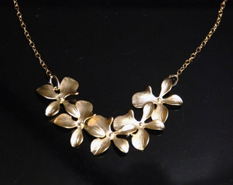 Gold orchid cascade necklace