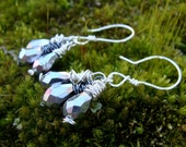 Three gray crystal beads wrapped in silver and hematite