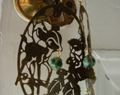 Oh deer. Cute deer filigree earrings in antique bronze finish with green accents.