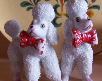 two poodle dog figurines