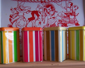 four little striped tin boxes