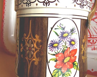 little brown tin with handle