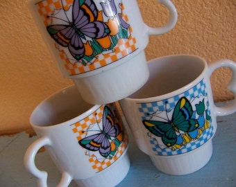 three charming butterfly and tulips mugs