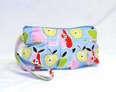 New Pleated Wristlet in fun apple and pear print in shades of pink, yellow, green and red on light blue