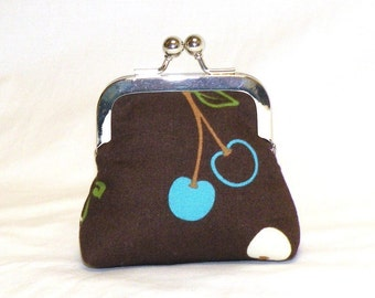 Happy Little Coin Pouch in cherries print in turquoise, green, and white on brown background
